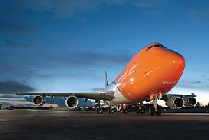TNT branded aeroplanes being loaded on runway